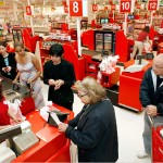 Woman in the process of being offered a Target card