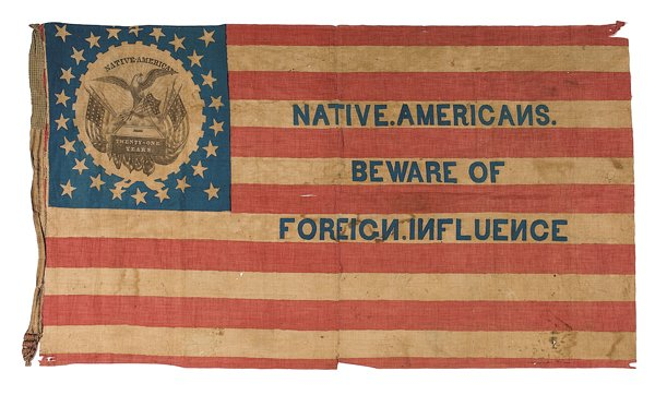 "It's the 1850s Know-Nothing flag. Fun fact: By ""Native Americans"" they meant white folk born in the USA and not from the mud countries of Germany and Ireland."
